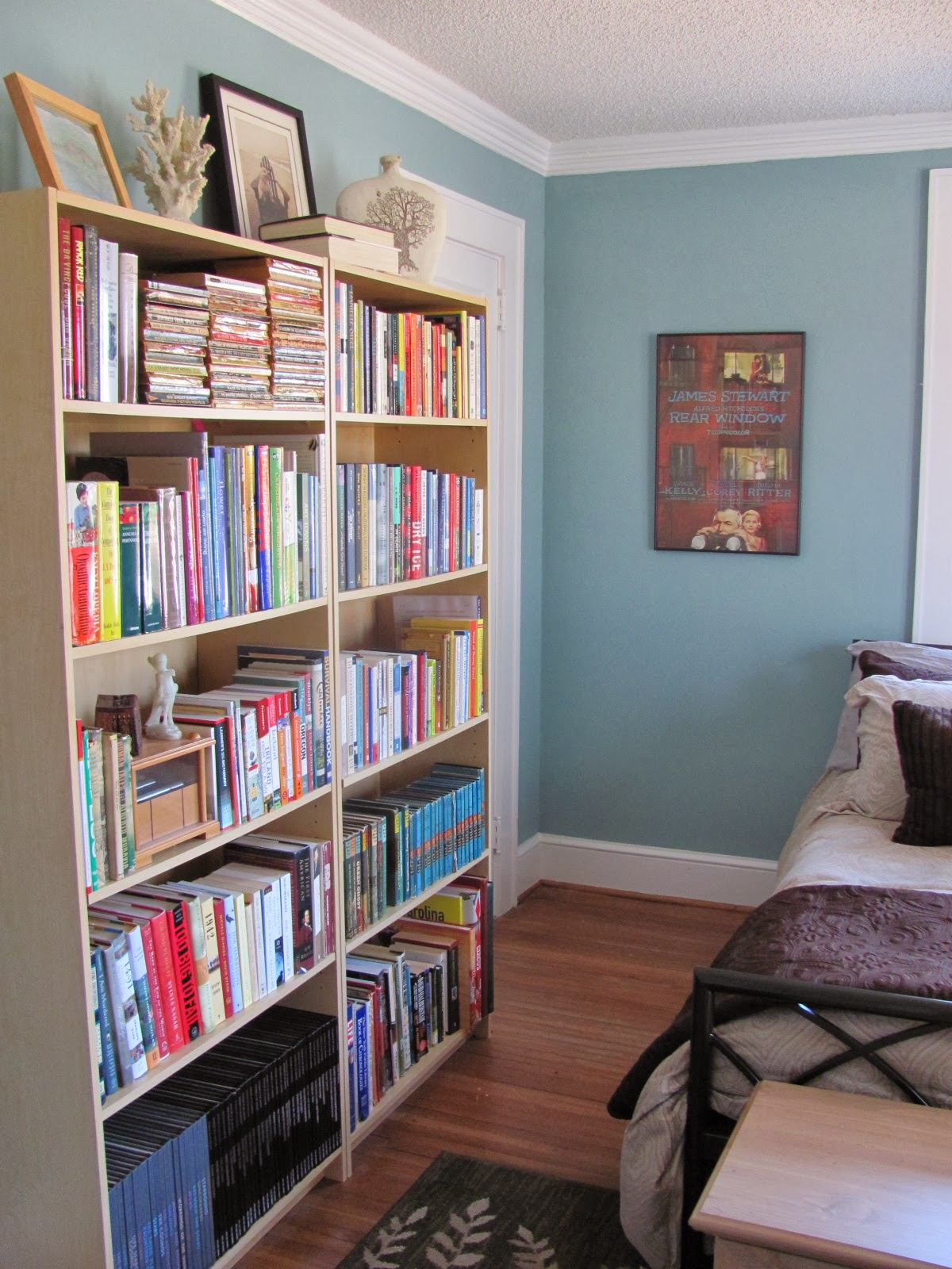 small guest bedroom library after organization and redesign