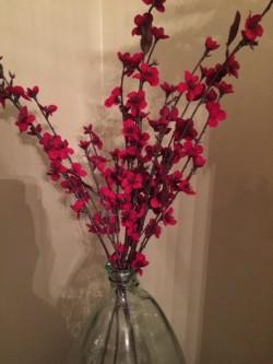Christmas flower arrangement in dining room.